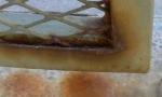 Examinar y reparar cerrajería oxidada